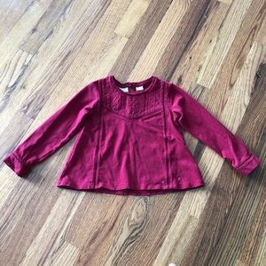 Long sleeve t-shirt. Color is really red.